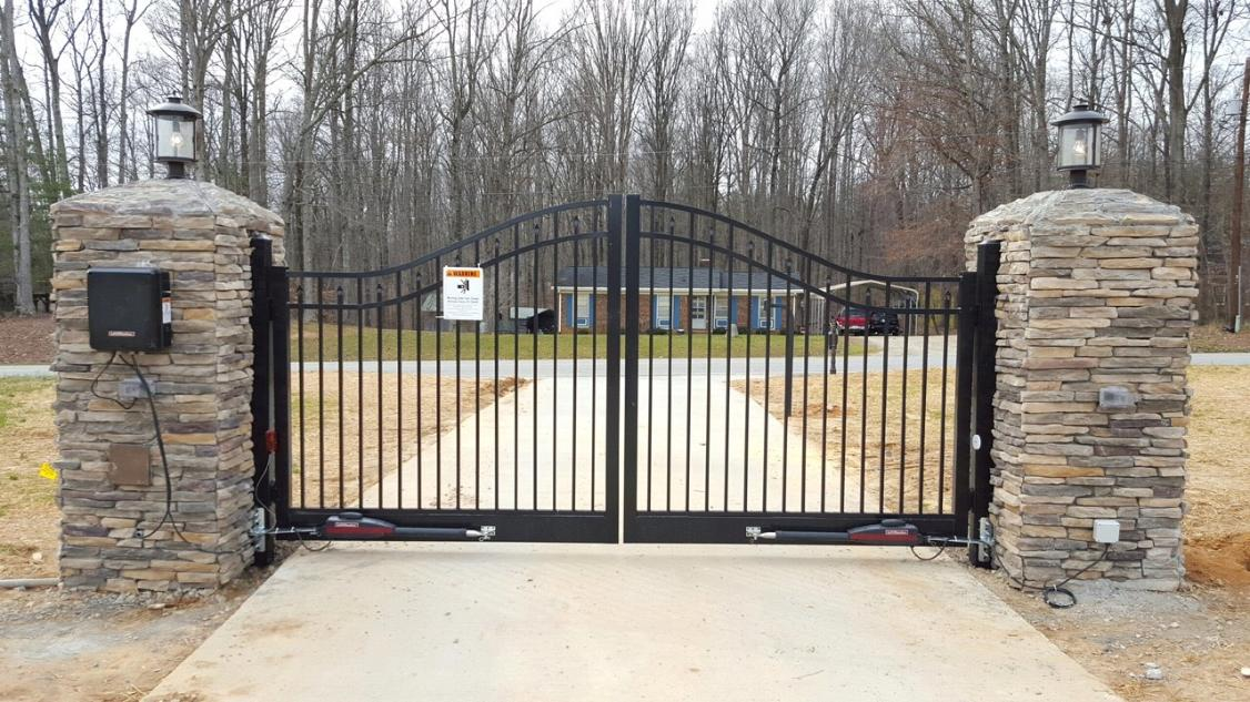 Stone columns with steel gate Liftmaster openers